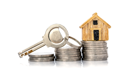 Close up house model place on stacking of money coin for home mortgage and loan ,  refinance or property investment concept