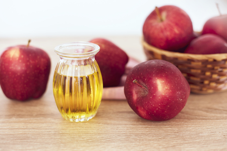 Close up red Apple fruit  and an apple cider vinegar juice , Helps Lose Weight and Reduces Belly Fat , healthy food
