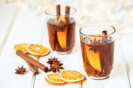 Mulled wine on white table in night celebration of  New Year party and delicious Christmas drink for autumn and winter season