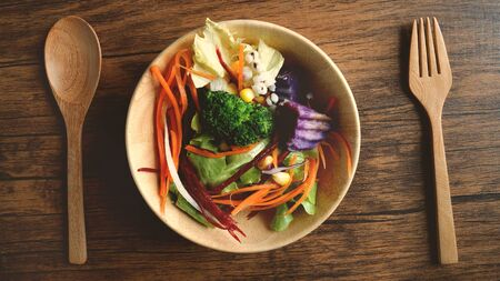 Close up salad bowl , healthy vegan organic vegatable foods , above or top view overhead shot