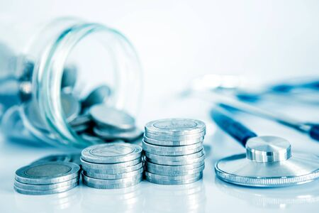 Health  insurance and Money saving for Medical Healthcare disease insurance concept , coin money jar with stethoscope