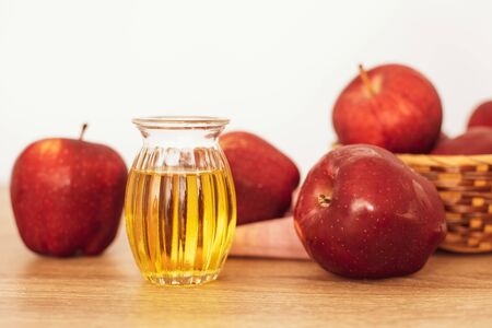 Close up red Apple fruit  and a apple cider vinegar juice , Helps Lose Weight and Reduces Belly Fat , healthy food
