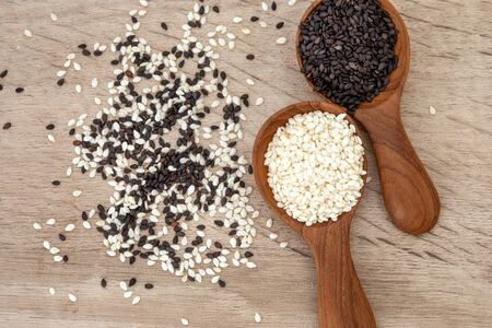 organic Black and White sesame seeds in wooden spoon ,healthy food for reductions in both systolic and diastolic blood pressure 写真素材