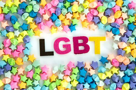 LGBT lettering placed on white background with colorful star paper craft , diversity LGBT concept
