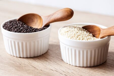 organic Black and white sesame seeds in wooden spoon