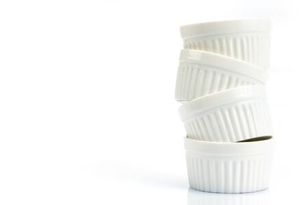 stacking of small white bakery cup on white background 写真素材