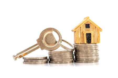Close up house model place on stacking of money coin for home mortgage and loan,  refinance or property investment concept
