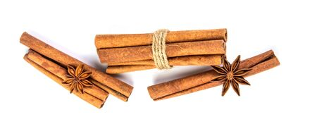Close up brown cinnamon stick with star anise spice isolated on white background, overhead and top view