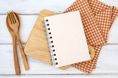 book notepad paper on chopping cutting board and tablecloth on white table, recipes food  for healthy habits shot note background concept 写真素材