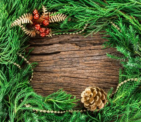 The Christmas ornaments on wooden background as frame border with copyspace