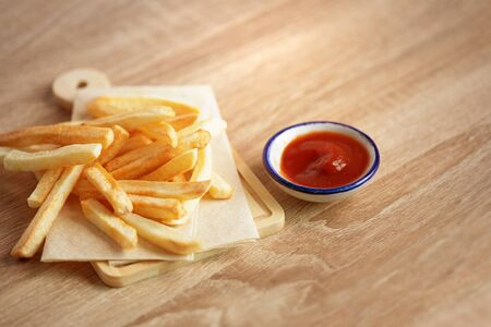 Close up French Fries with a tomato sauce on the table, fatty unhealthy  junk food concept 写真素材