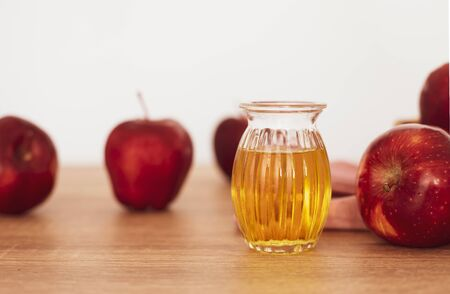 Close up red Apple fruit  and a apple cider vinegar juice, Helps Lose Weight and Reduces Belly Fat, healthy food