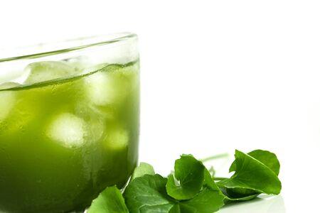 Fresh green Gotu kola, Centella asiatica leaf and juice on white background , Asiatic pennywort, Indian pennywort , ayurvedic medical herb concept