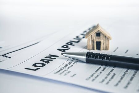 Close up a Loan Application form paper with pen , home loan or personal loan application concept