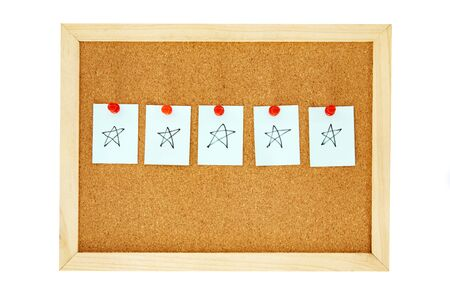 note paper on cork pin board with give five star , symbol of excellent customer satisfaction feedback concept , isolated on white