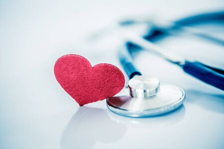 Health  insurance and Medical Healthcare heart disease concept , red heart shape with stethoscope on white background Zdjęcie Seryjne