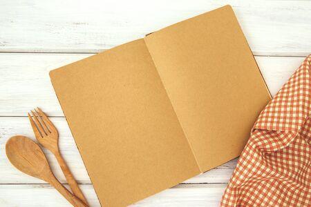 brown recipe cooking book on white wooden bord Zdjęcie Seryjne