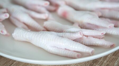 close up fresh raw chicken feet prepared in dish for cooking