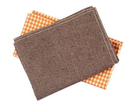 crumpled orange brown checkered napkin table clothes  on white background.