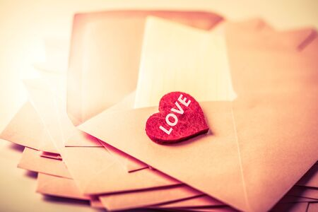 close up Stacking of pink envelopes and mail letter paper and red herat , romance  love letter concept for holiday valentines day greeting card concept Zdjęcie Seryjne