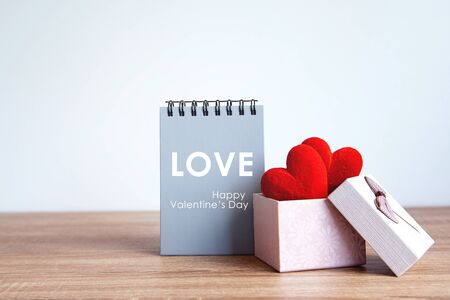 The red Heart shapes  in gift box , love concept for valentines day with sweet and romantic moment