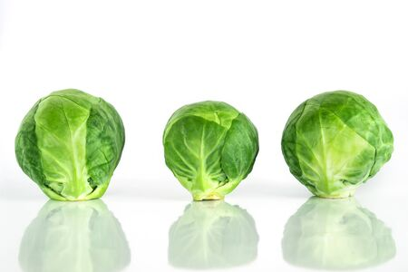 Fresh green brussel sprouts vegetable on white background