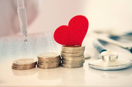 Health  insurance and Medical Healthcare heart disease concept , a red heart shape with stethoscope , financail healthcare