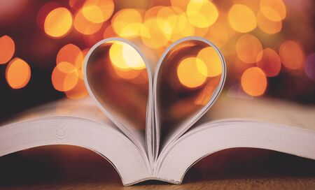 Book page decorate to heart shape with celebration bokeh light for love and romance of valentines day concept Zdjęcie Seryjne