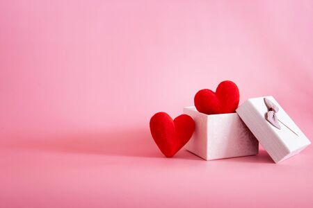 The red Heart shapes  in gift box on sweet pink background , love concept for valentines day with sweet and romantic moment