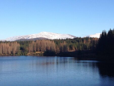 snow covered mountains: Loch with snow covered mountains