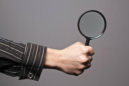 wrist cuffs: Magnifying glass Stock Photo