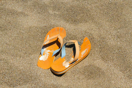 flip flops on the sand photo
