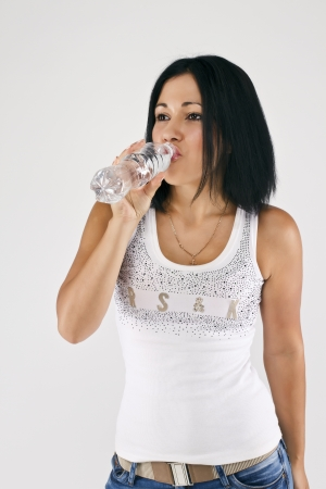 A girl drinks water  photo