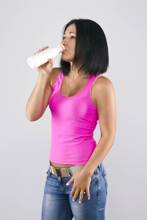 Woman drinking yoghurt photo