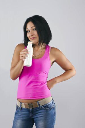 Woman drinking yoghurt photo