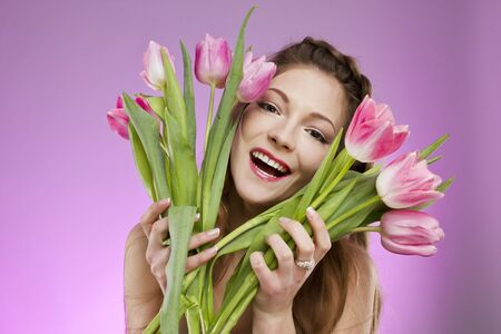 Happy girl with tulips Stock Photo