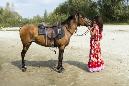 Girl with horse photo