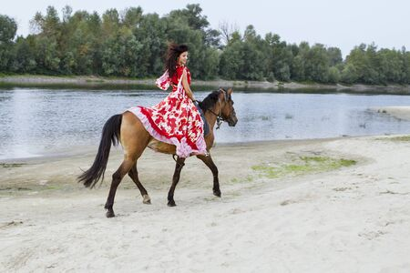 Girl riding a horse photo