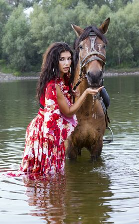 The girl gives a water horse