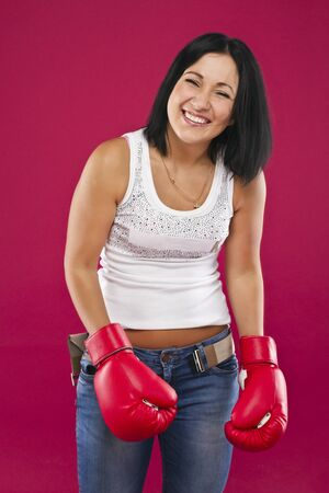 The girl in boxing gloves. photo