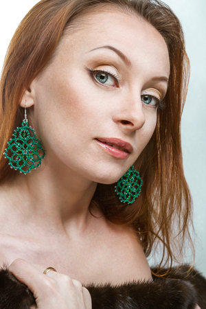 insightful: Luxury woman with green lace earrings Stock Photo