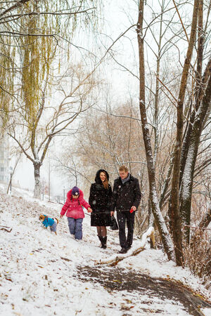 Family walk in nature photo