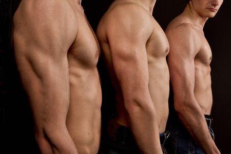 torsos: Three men bare torsos Stock Photo