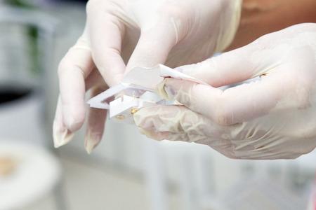 滅菌手袋で手 写真素材