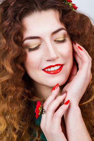 Curly girl with red lips and decorations