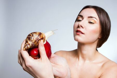 apple snail: A girl with a snail on the apple