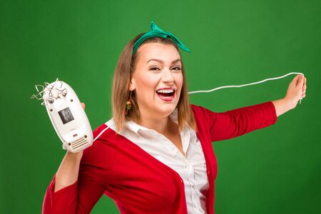 christmas baker's: Joyful woman with a mixer Stock Photo