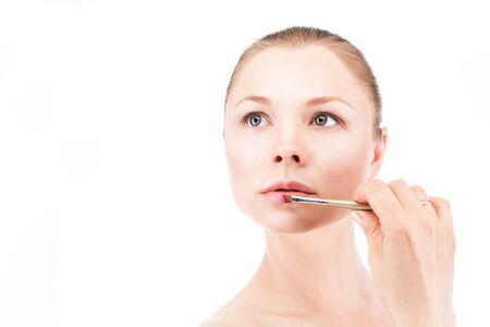 cheekbones: Woman paints lips