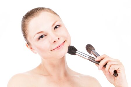cheekbones: A woman with a brush for powder