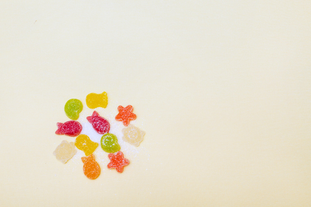 Fruit-shaped figures in a marine style on a background with space for text. Stock Photo